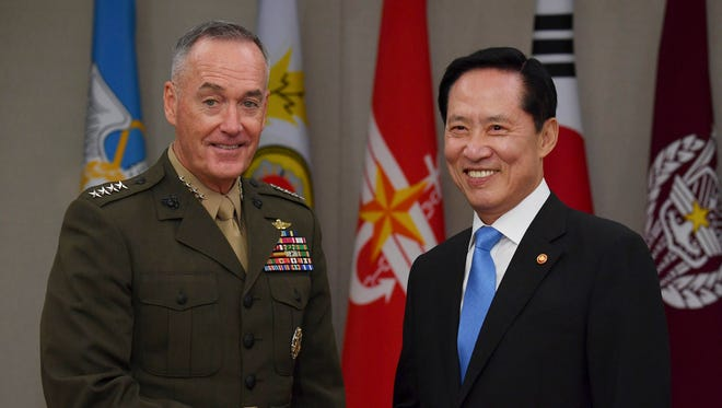Marine Corps General Joseph Dunford, chairman of the Joint Chiefs of Staff, shakes hands with South Korean Defense Minister Song Young-Moo.
