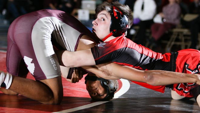 Phillipsburg's Travis Jones and Hunterdon Central's Jack Bauer wrestle in the 120 pound weight class bout at Hunterdon Central on Jan. 10, 2018.