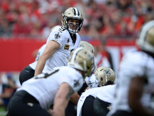 New Orleans Saints quarterback Drew Brees (9) at the line of scrimmage against the Tampa Bay Buccaneers during the first half of an NFL football game Sunday, Dec. 9, 2018, in Tampa, Fla. (AP Photo/Jason Behnken)