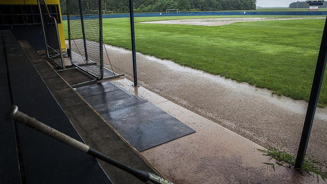A baseball dugout at Delta High School with soccer fields nearby.