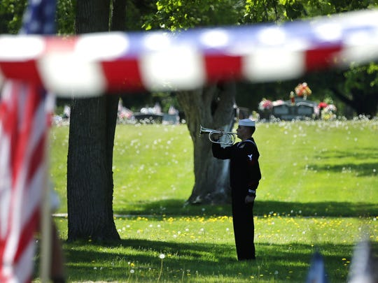 "Sgt. Elden W. Grimm, a U.S. Marine from Menasha who died in battle during World War II is buried with full military honors Saturday at Oak Hill Cemetery in Neenah. In October 2016, the Defense POW/MIA Accounting Agency, with the aid of new forensic technology, resumed the uncovering of ""unknowns"" from the battle of Tarawa and Grimm was identified less than a year later."