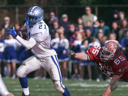 Manasquan's Kaysonne Anderson breaks free for yardage against Wall on Thanksgiving Day in 2002.