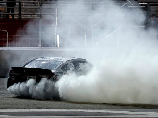 Kevin Harvick (4) does a burnout after winning a NASCAR Cup Series auto race at Atlanta Motor Speedway in Hampton, Ga., on Sunday, Feb. 25, 2018. (AP Photo/John Bazemore)