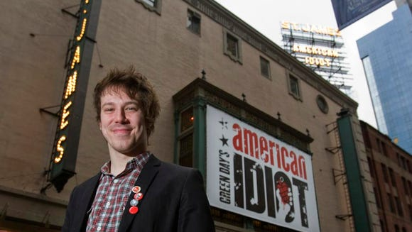 John Gallagher Jr. in front of the marquee at St. James