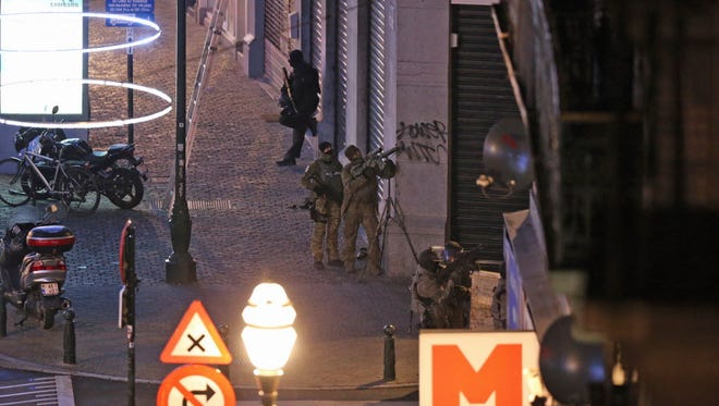 Belgium special forces perform street searches in the Rue Antoine Dansaert in the city center of Brussels on Dec. 20, 2015.