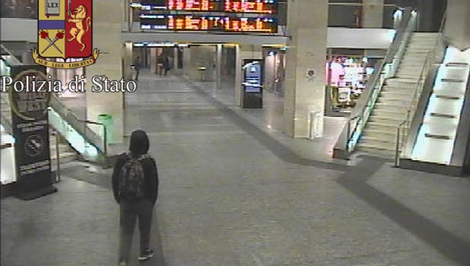 In this frame grab made available by the Italian police, Anis Amri, the main suspect in Berlin's deadly Christmas market attack, walks through a train station on Dec. 22.