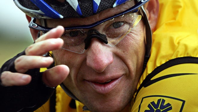 Lance Armstrong, shown in 2004, settled his civil suit Thursday.