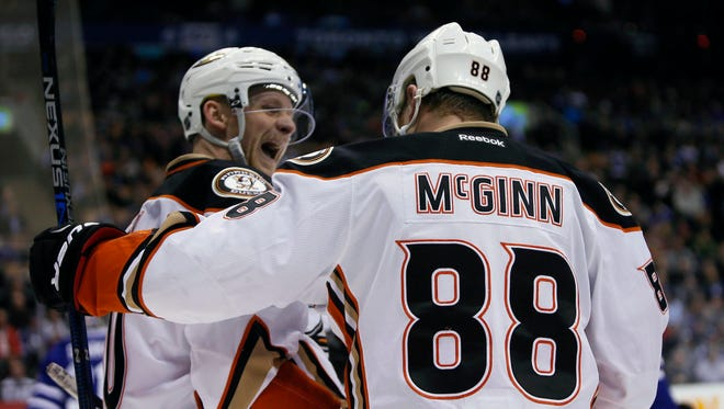Jamie McGinn (right) anticipated being moved last season by the Sabres, setting up a cross-country move to the Ducks.