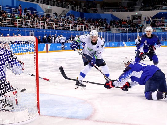 U.S. defenseman Chad Billins and goaltender Ryan Zapolski defend against Slovenia forward Rok Ticar during play at the 2018 Olympic Winter Games at Kwandong Hockey Centre.