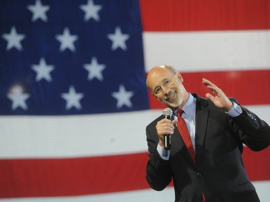 Tom Wolf talks to his supporters during a rally at