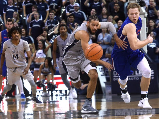 Nevada's Cody Martin fights for a loose ball during
