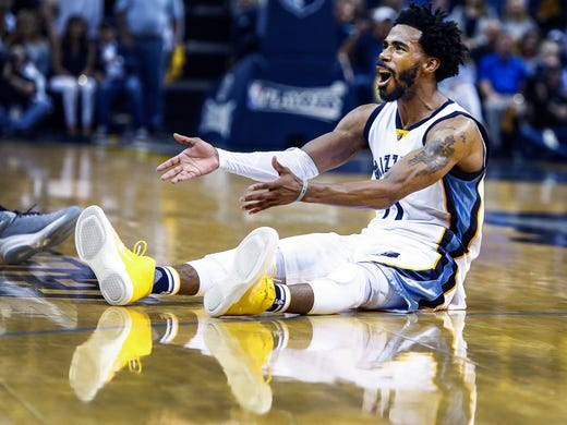 Memphis Grizzlies guard Mike Conley reacts to the officials
