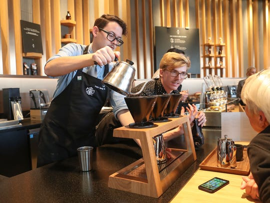 Starbucks employees Kurt Vaugh, right, and A.J. Gardilla