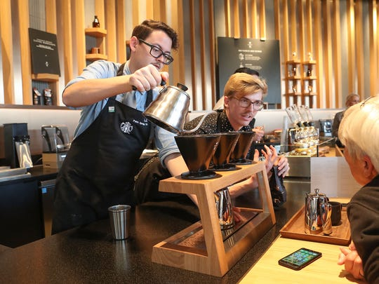 Starbucks employees Kurt Vaugh, right, and A.J. Gardilla brew coffee and explain the process they use at the new Starbucks Reserve in Palm Springs, November 17, 2017.