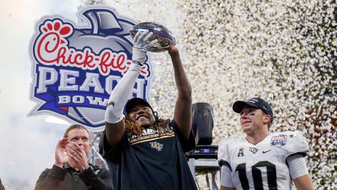 Central Florida linebacker Shaquem Griffin and quarterback McKenzie Milton celebrate a victory against Auburn in the 2018 Peach Bowl.