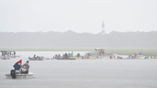 Spectators await the beginning of the 93rd Spectators await the beginning of the 93rd annual pony swim on Wednesday, July 25, 2018 in Chincoteague Island, Va. in the rain on Wednesday, July 25, 2018 in Chincoteague Island, Va.
