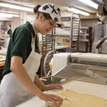 Kirsten Voss, wearing her signature cow print hat, works as a student manager at the University of Wisconsin-Stevens Point Dining and Summer Conferences bakery. She was recently named the National Association of College and University Food Services Student Employee of the Year.