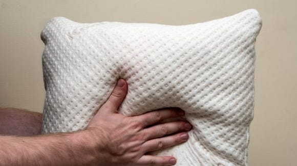 This memory foam pillow will seriously change your sleep.