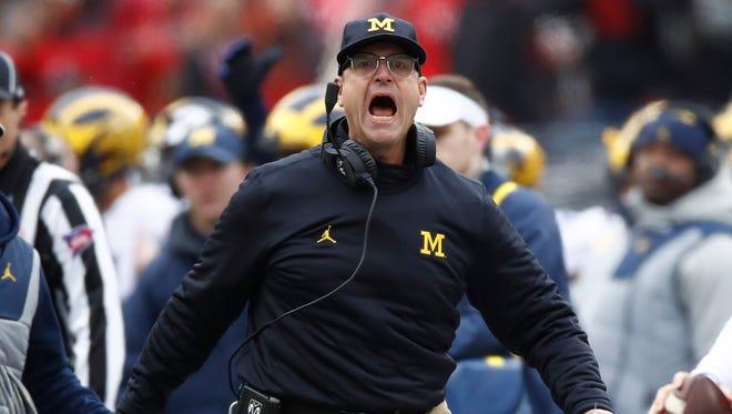 Jim Harbaugh argues a call Saturday against Ohio State.