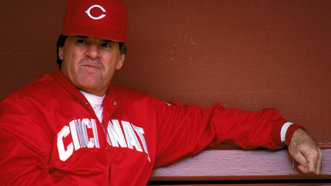 Then-Reds Manager Pete Rose sits in the dugout during a game in 1989. He is now seeking reinstatement to baseball following his punishment over gambling allegations that year.