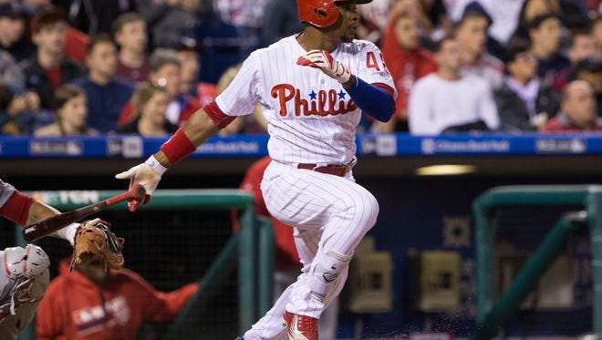 Phillies left fielder Cedric Hunter hits a single during the fourth inning Friday against the Washington Nationals at Citizens Bank Park. Hunter was optioned to Triple-A before Wednesday's game.