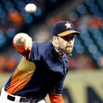 Houston Astros' Collin McHugh delivers a pitch against the Seattle Mariners in the first inning of a baseball game in Houston.