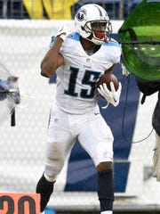 Tennessee Titans wide receiver Justin Hunter (15) celebrates receiving a pass against the Carolina Panthers during the fourth quarter of the NFL preseason football game at Nissan Stadium, Saturday, Aug. 20, 2016, in Nashville, Tenn. The Titans lost 26-16.