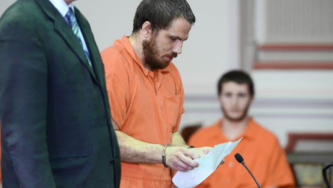 Larry Colebank Jr. reads a statement during his sentencing in Muskingum County Common Pleas Court on Monday. Colebank Jr. was sentenced to two years in prison for selling drugs. His father, Larry Colebank Sr. was previously sentenced after a raid on the Colebanks home in Trinway earlier this year.