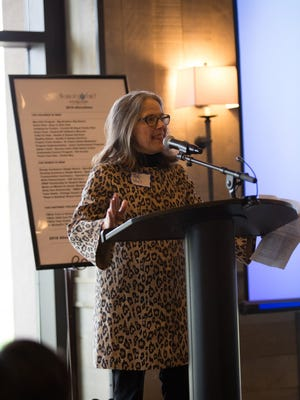 Patty Noel speaks after receiving the SPARK Philanthropy Award during the Women's Fund of Portage County's Spring Luncheon on May 11 at SentryWorld.