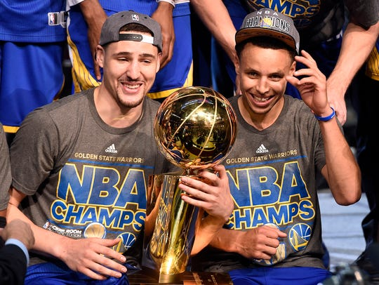 Klay Thompson and Stephen Curry celebrate their NBA championship in 2015.