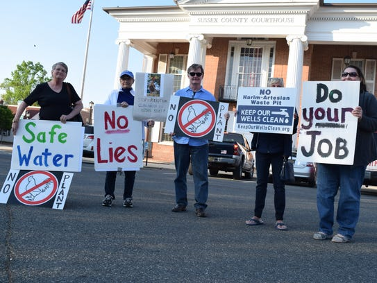 Sussex County residents protested in Georgetown in advance of a public hearing considering Allen Harim Foods LLC's plans to debone chickens at a former pickle plant near Millsboro.