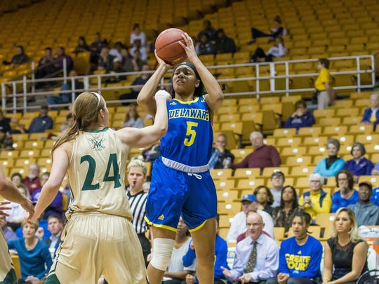 Makeda Nicholas eyes the basket in Delaware's CAA Tournament loss to William & Mary while Abby Rendle defends.