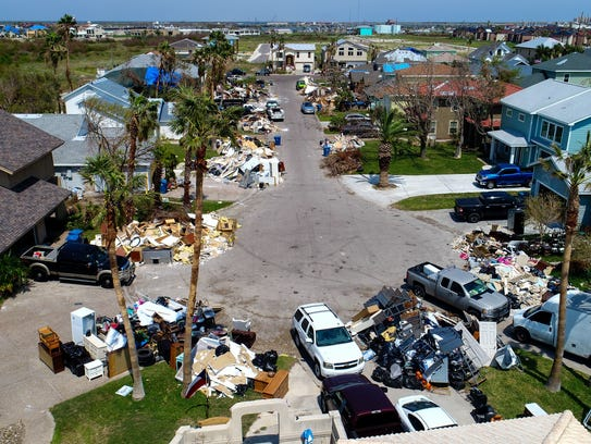 Debris from homes damaged by Hurricanes Harvey lines