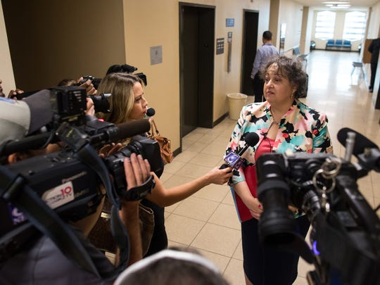Attorney Karen Marvel speaks to the media after a court