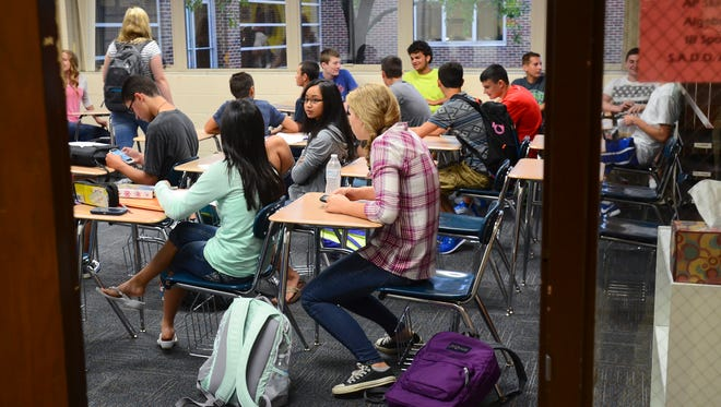 Students wait for class to start on their first day of school Tuesday at Algonac Junior-Senior High School.