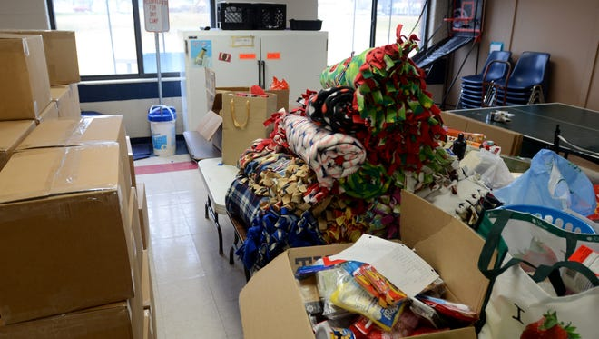 Stuffed stocking goods for service men and women are ready to be boxed Monday, Dec. 14, at the Port Huron Rec Department at Palmer Park.