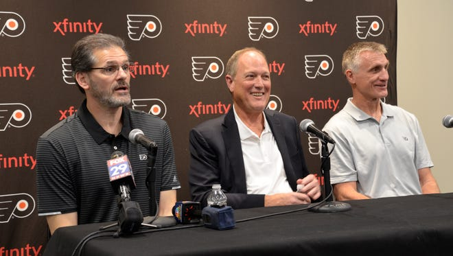 Flyers general manager Ron Hextall, Comcast Spectacor chairman and CEO Dave Scott and team president Paul Holmgren held a rare joint press conference Wednesday.