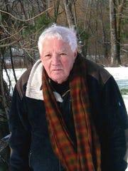 Larry Linn, an avid 80-year-old gardener, cares for