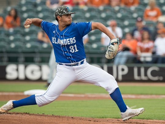 Texas A&M- Corpus Christi's Leonel Perez throws a pitch during the first inning of their game against Texas at Whataburger Field on Tuesday, April 3, 2018.