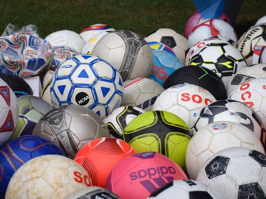 New and used soccer balls donated by members of SOCA