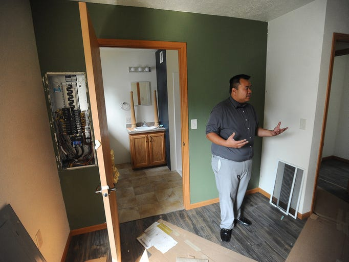 Lim Bun stands in the master bedroom of his new governor's house in the Whittier neighborhood on Thursday, Sept. 4, 2014. The program recently started offering three-bedroom houses.