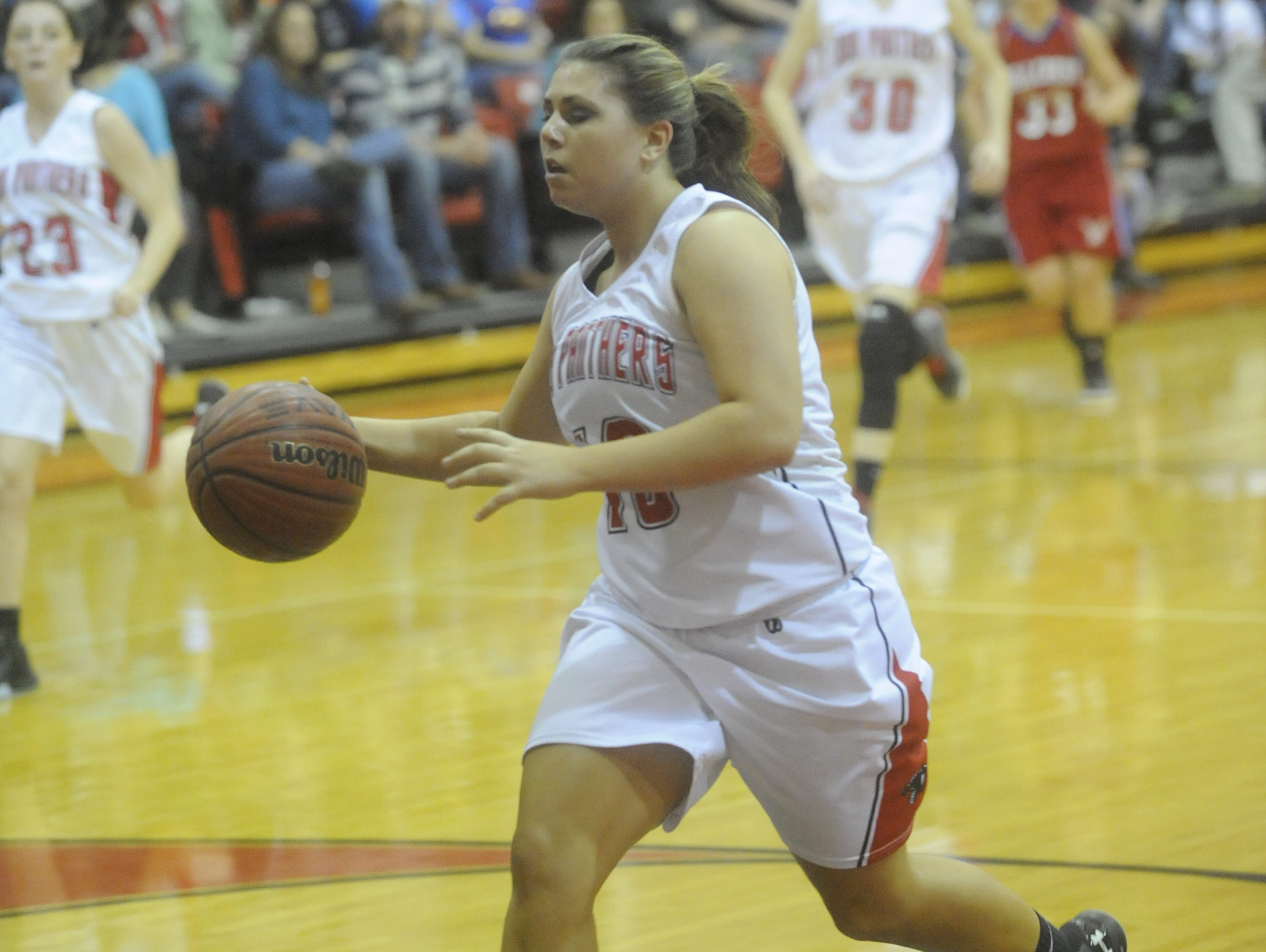 Norfork homecoming queen Abbie Belding drives the lane for two points during the Lady Panthers' 73-31 win over Hillcrest on Friday night.
