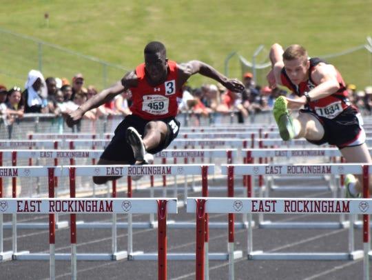 Riverheads' Josh Akinwumi, center, competes in the