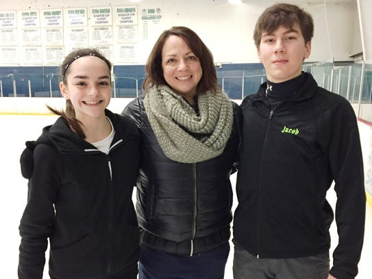 Figure skating coach Michelle Hunt (middle) has taken