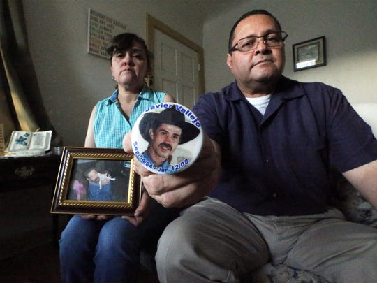 """Estella Vallejo and her brother, Richard Vallejo, hold mementos of their brother, Javier """"Curly"""" Vallejo, 43, who died after hitting his head while being assaulted during a street robbery in 2008."""