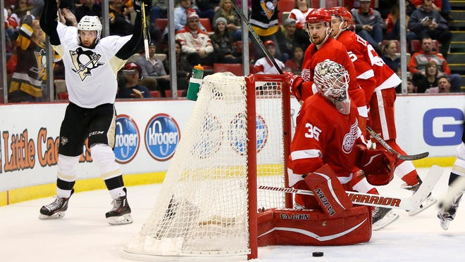 The Penguins' Nick Bonino celebrates his third-period goal, scored against Jimmy Howard. The Penguins defeated the Red Wings 7-2.