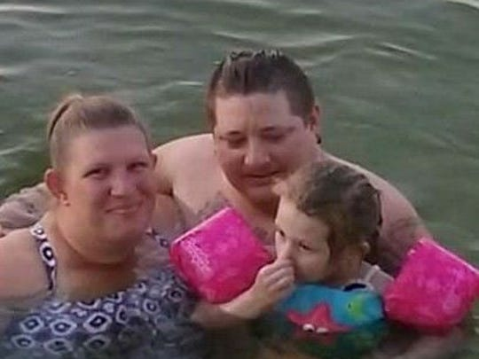 Ginger Wright, from left, Josh and Dakota Wright swimming in a lake they enjoyed to visit in August 2016.