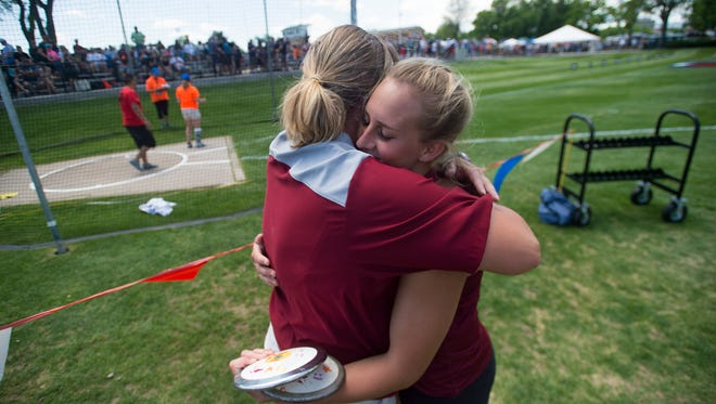 Gabriella McDonald of Rocky Mountain High School and her throws coach, Katie Hansen, celebrate after McDonald won the 5A discus event during the CHSAA State Track and Field Championships at JeffCo Stadium in Lakewood on Thursday.