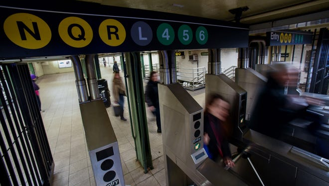 Commuters exit the 14th Street-Union Square subway station in New York.