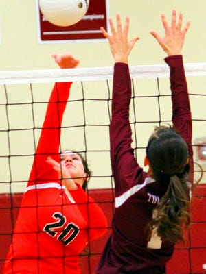 Loving's Jacqueline Pierce hits the ball over the net against Tularosa's Allysa Montoya in Thursday's District 4-3A tournament semifinals.